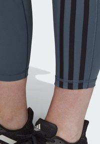 adidas Performance - BELIEVE THIS 3-STRIPES 7/8 LEGGINGS (PLUS SIZE) - Medias - green - 4