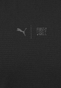 Puma - TRAIN FIRST MILE SLEEVELESS TEE - Top - black - 2