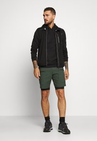 Peak Performance - TRACK SHORTS - Sports shorts - drift green - 1