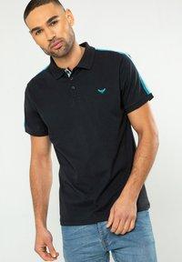 FINN - Polo shirt - blau