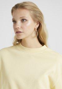 ERASE - TWIST CHUNKY HOOP  - Øredobber - gold-coloured - 1