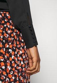Vila - VILUCY BUTTON V NECK - Button-down blouse - black - 4