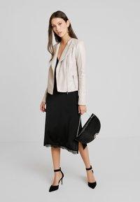 Forever New - NINA COLLARLESS BIKER - Faux leather jacket - mink - 1