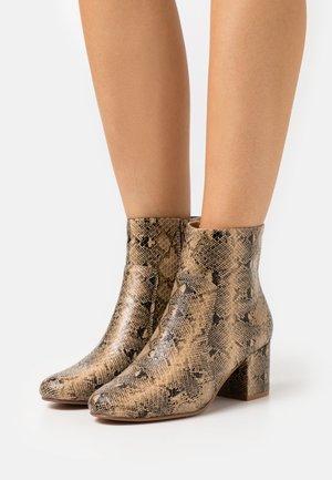 Kotníková obuv - gold coloured