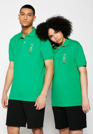 POLAROID UNISEX - Polo shirt - malachite