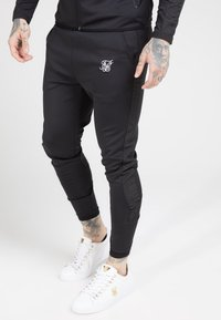 SIKSILK - CREASED PANTS - Spodnie treningowe - black