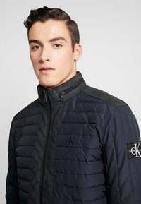 Calvin Klein Jeans - PADDED HOOD ZIP THROUGH - Light jacket - black - 5
