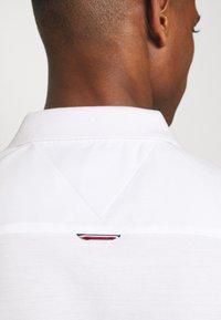 Tommy Hilfiger - CONTRAST PLACKET SLIM  - Polo shirt - white - 4