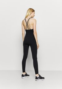 NU-IN - CROSS BACK LONG BODYSUIT - Gym suit - black