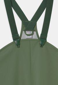 Lindex - MINI RAIN TROUSERS UNISEX - Rain trousers - dusty green - 2