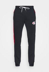 Champion - OFF COURT CUFF PANTS - Tracksuit bottoms - dark blue/white - 4
