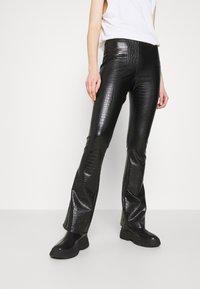 Topshop - CROC FLARE - Trousers - black - 0