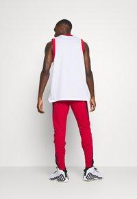 Jordan - AIR DRY PANT - Pantaloni sportivi - gym red/black - 2