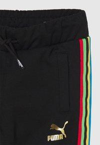 Puma - WORLDHOOD TRACK PANTS  - Tracksuit bottoms - black - 3