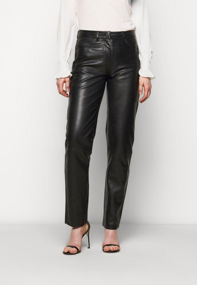 GRETA TROUSERS - Pantaloni di pelle - black