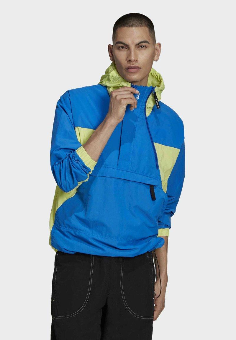 adidas Originals - ADIDAS ADVENTURE MISHMASH BLOCKED SHELL JACKET - Windbreaker - yellow