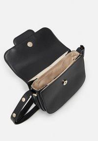 Guess - HENSELY MINI XBDY FLAP - Across body bag - black - 2