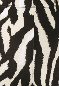 Saint Tropez - DAVINA - Leggings - Trousers - black grand zebra - 2