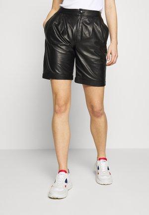 CAROLINE SHORTS - Leather trousers - black