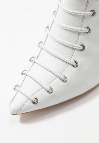 KIOMI - Bottes à lacets - white - 2