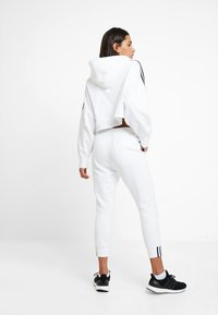 adidas Originals - PANT - Tracksuit bottoms - white - 2