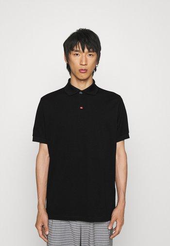 CHARM BUTTON - Polo shirt - black