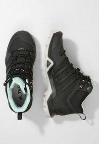 adidas Performance - TERREX SWIFT R2 MID GORE-TEX - Hiking shoes - core black/ash green - 1