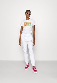 Versace Jeans Couture - PANTS - Tracksuit bottoms - white - 1