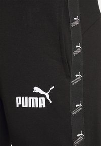 Puma - AMPLIFIED - Tracksuit bottoms - black - 6