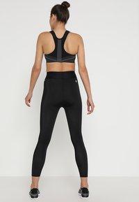 Skins - DNAMIC PRIMARY SKY - Leggings - black - 2