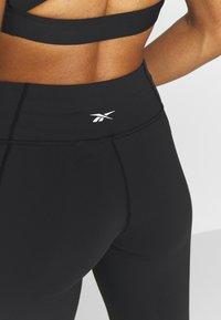 Reebok - LUX 3/4 - 3/4 sports trousers - black - 4