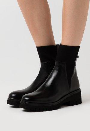 KELLY - Platform ankle boots - black