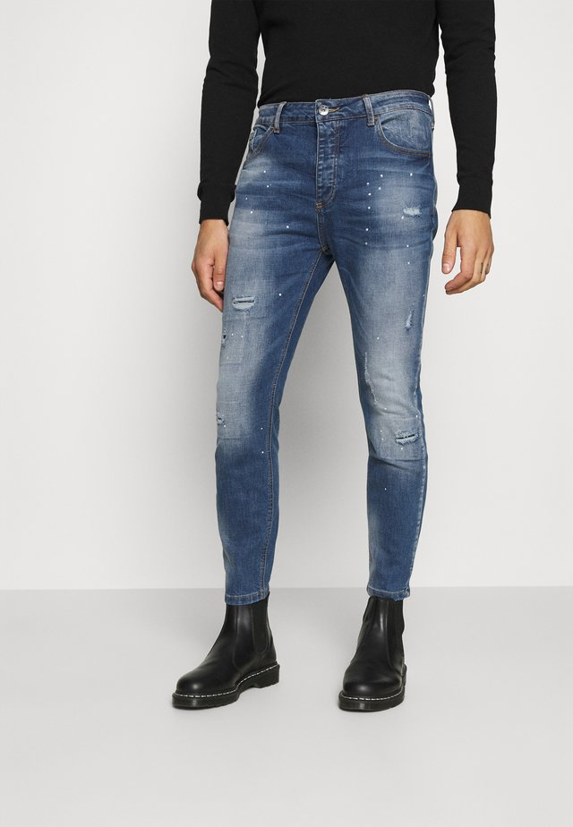 KASSALA CARROT  - Jeans Tapered Fit - indigo
