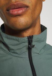 adidas Originals - SLICE - Training jacket - black/blue oxide - 5