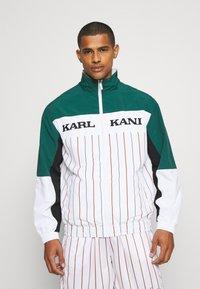 Karl Kani - RETRO BLOCK PINSTRIPE TRACKJACKET - Giacca leggera - white - 0