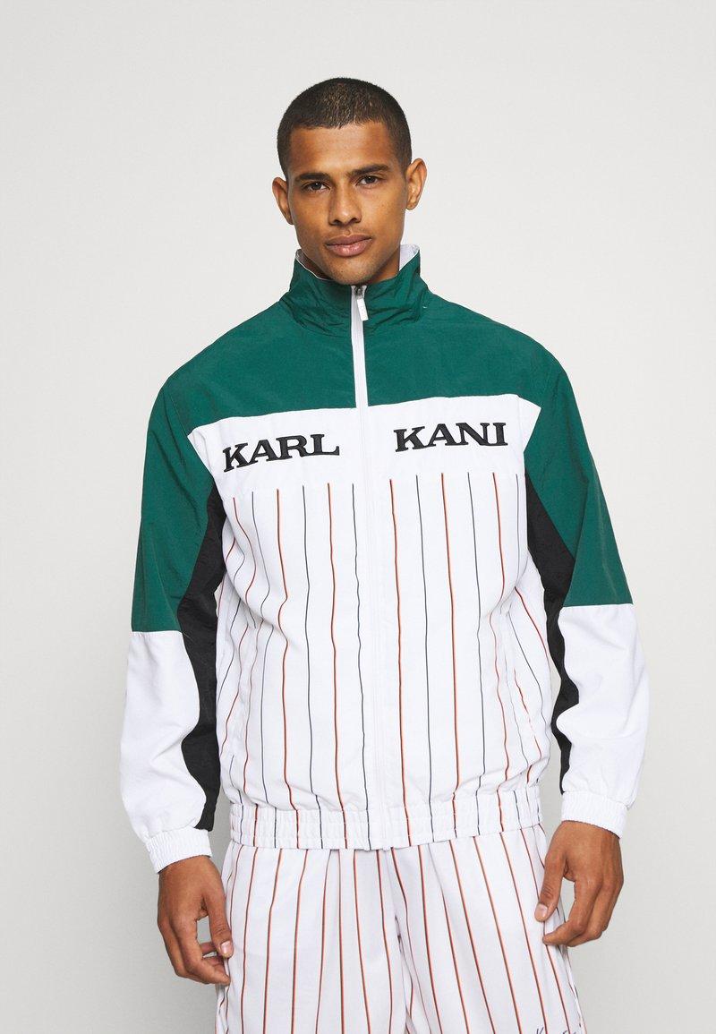 Karl Kani - RETRO BLOCK PINSTRIPE TRACKJACKET - Giacca leggera - white