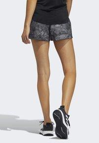 adidas Performance - PACER WOVEN FLORAL SHORTS - Pantaloncini sportivi - black - 1
