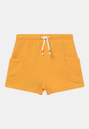 SIDE POCKETS - Shorts - amber yellow