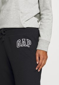 GAP - Tracksuit bottoms - true black - 3
