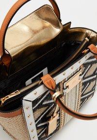 River Island - WEAVE STUD WING TOTE - Handbag - beige - 2