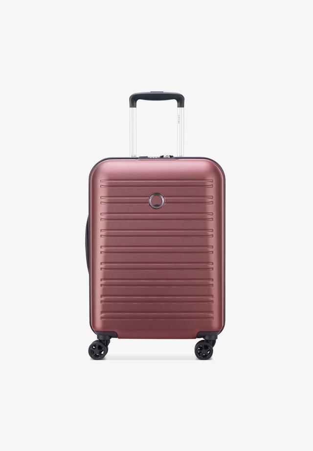 SEGUR - Wheeled suitcase - purple