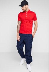 Lacoste Sport - TENNIS PANT - Pantalon de survêtement - navy blue - 1