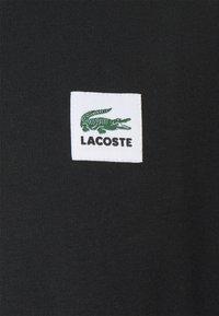 Lacoste LIVE - UNISEX - Basic T-shirt - black - 2