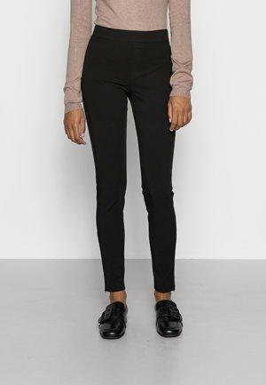 SLIM FIT MID RISE ZIPPER DETAIL - Leggings - Trousers - black