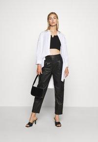 Topshop - ELLA  - Leather trousers - black - 1