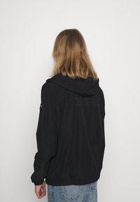 Ellesse - BOLAZIONI WINDRUNNER - Summer jacket - black - 2
