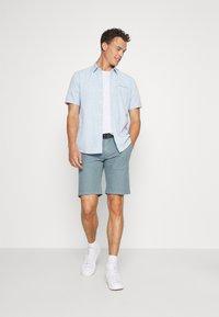s.Oliver - BERMUDA WITH BELT - Shorts - light blue - 1