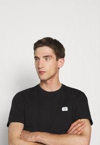 C.P. Company - SHORT SLEEVE - Basic T-shirt - black - 4