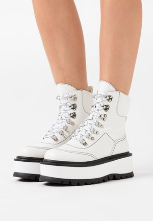VEGAN HYDRA - Platform ankle boots - white