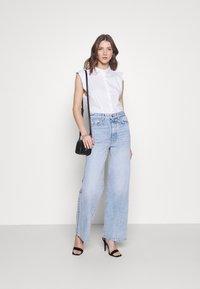Gina Tricot - IDUN WIDE - Flared Jeans - bleached blue - 1